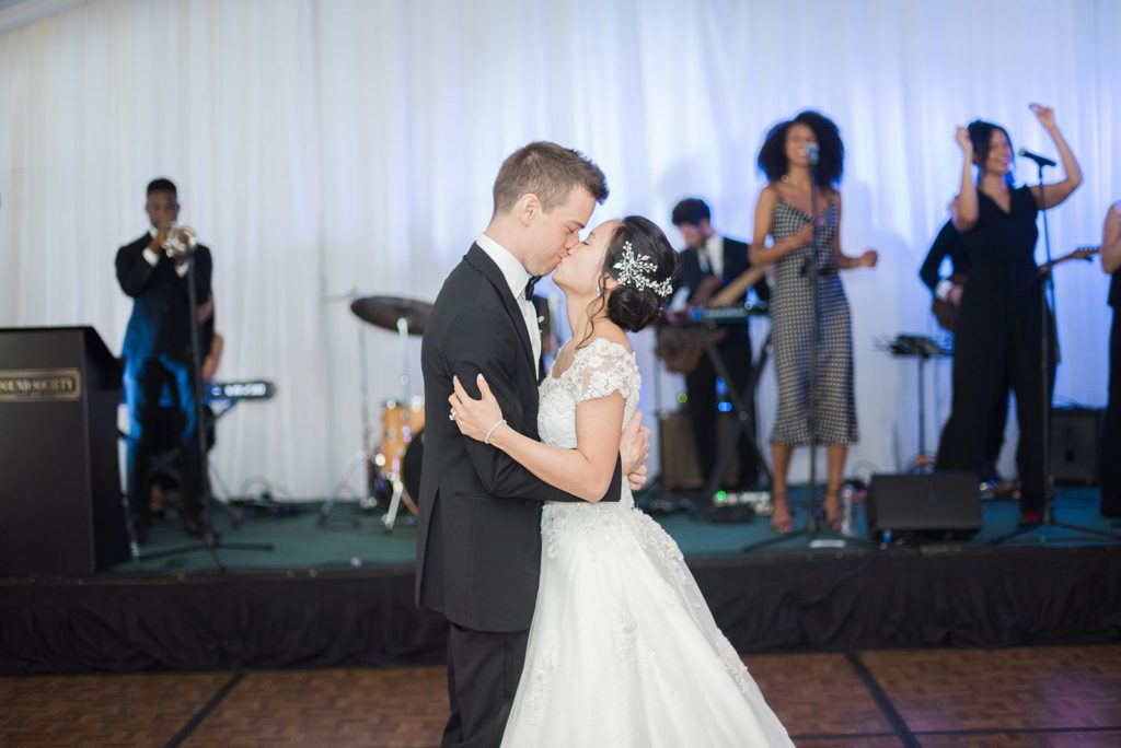 Couple kissing during first dance.